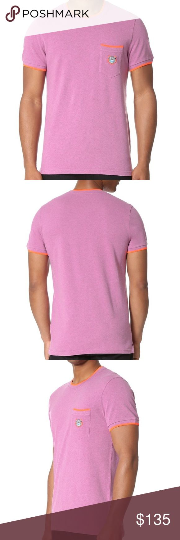 Kenzo Tiger Crest Pique Pocket Tee New 2016/17 Sold Out RARE authentic Kenzo Paris men's heathered pink/purple with green/Orange Contrast edging adds a pop of neon color to this crew-neck KENZO tee. Logo embroidery at the breast pocket. Short sleeves. Split hem. Fabric: Piqué. 100% cotton. Wash cold. Made in Portugal. Length: 28.25in / 72cm Chest: 41in / 104cm Cut slim. For a modern/slim fit, buy your normal size. For a classic/regular fit, buy 1 size larger than your normal. Ships fast from…
