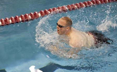 Marine veteran Cpl. Travis Greene, native of Boise, Idaho, swims the breastroke during swim practice for the 2012 Warrior Games at Colorado Springs, Colo., April 24, 2012. Greene, a bilateral above-knee amputee was injured in a secondary improvised explosive device blast in Dec. 2005. Green will be competing in sitting volleyball, wheelchair basketball and swimming during the Warrior Games. The Warrior Games is a competition between wounded warriors from all...  http://dvidshub.net/r/n6qenm