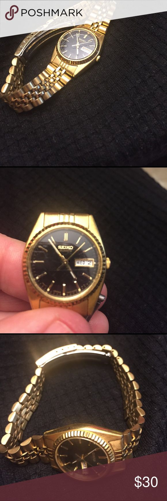 Seiko gold watch Gold seiko ladies watch, black face.  Small scuffs on crystal.  Will replace battery for buyer Accessories Watches