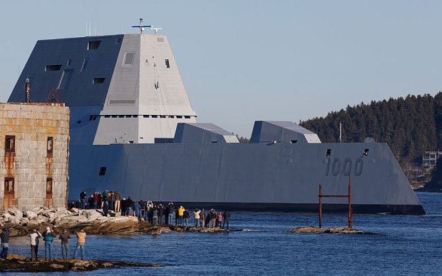 The first Zumwalt-class destroyer, USS Zumwalt, the largest ever built for the U.S. Navy, passes spectators at Fort Popham at the mouth of the Kennebec River
