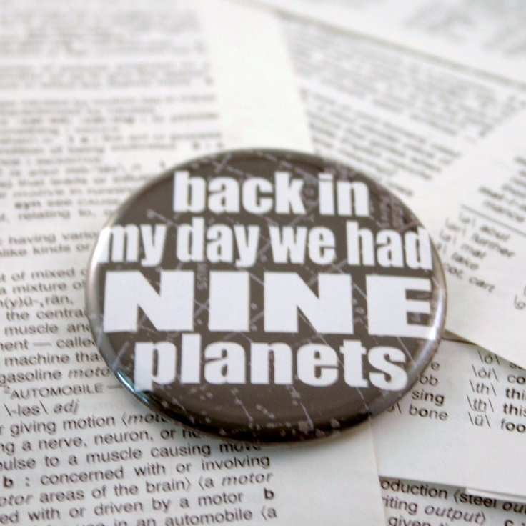 Back in my day we had NINE planets Black Pinback Button. $3.25, via Etsy.