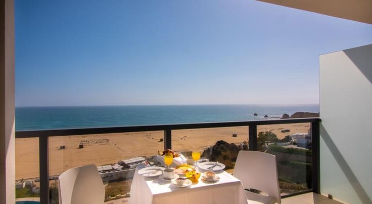 Hotel da Rocha Portimão Hotel da Rocha provides immediate access to Praia Da Rocha Beach. It features suites with a contemporary design offering beach or land views. The hotel provides free WiFi throughout and 24-hour reception services.