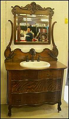 Photo of Front View - Antique Bathroom Vanity: Claw Foot Antique Dresser for Bathroom Vanity with Kohler Sink and Price Pfister Faucet