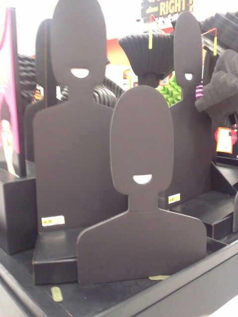 Found these simple human-shaped cutouts at my local Target store...thought they'd make a fun and different way to display jewelry (or hats, or wigs, or scarfs, or even shirts). They simply used foam-board and painted them black and then attached 2 (1 front, and slightly shorter, and 1 back and slightly taller) to a box (also painted black). Simple, easy, and lightweight...but impactful. You could paint them any interesting solid color to match your booth decor or to best-display your wares.