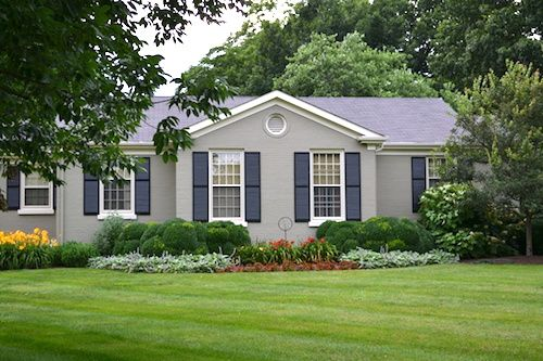 Pretty Gray Painted Brick Home - An easy way to update an old ranch. Read the post for additional inspiration.