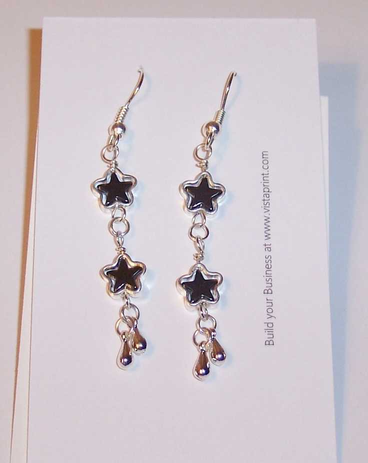Hematite stars inside silver plate stars with tiny dangles. $10