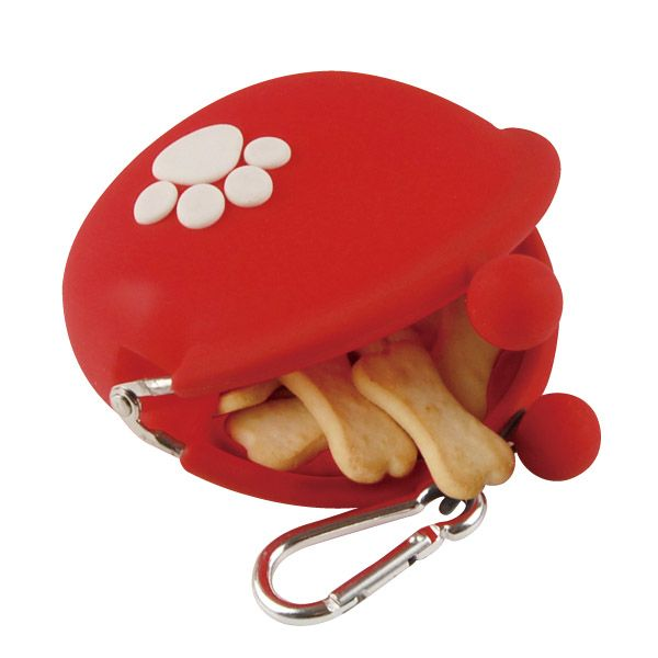 A charming coin purse bearing a paw  print. It is useful as a coin purse or when  walking your dog.