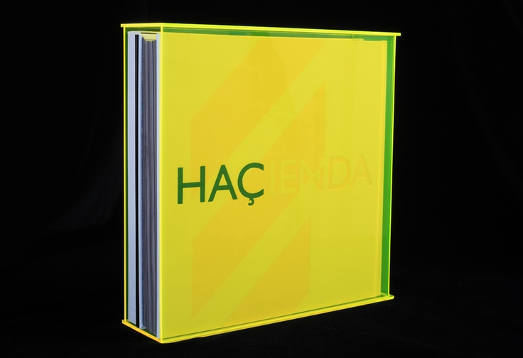 """The Signature Edition of the Foruli signed limited edition of 'The Hacienda: How Not to Run a Club' by Peter Hook of Joy Division and New Order. Includes a genuine piece of the Hacienda's maple floor, plus an exclusive 10"""" black vinyl EP and art print. Only 400 copies. Design by Andy Vella and Russell Hrachovec."""