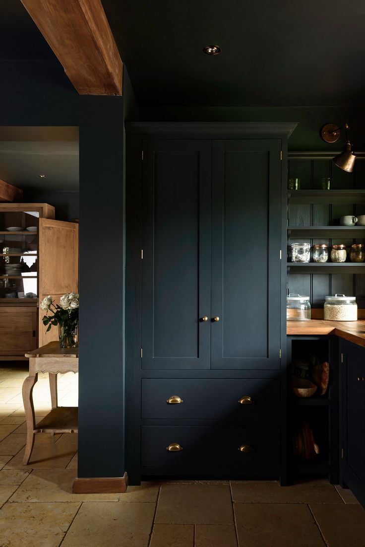 A beautiful big deVOL Pantry Cupboard painted in Pantry Blue with brass details.