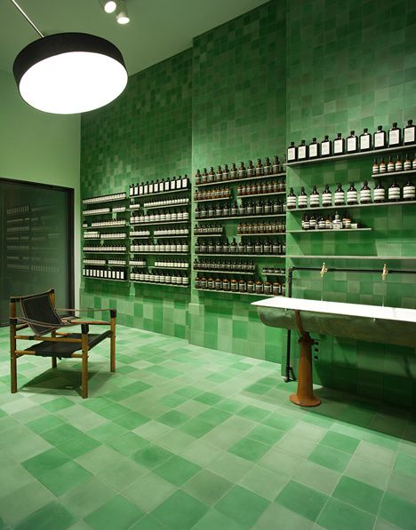 Aesop store Berlin by Weiss-heiten. Emerald-coloured tiles cover the walls, floors and surfaces.