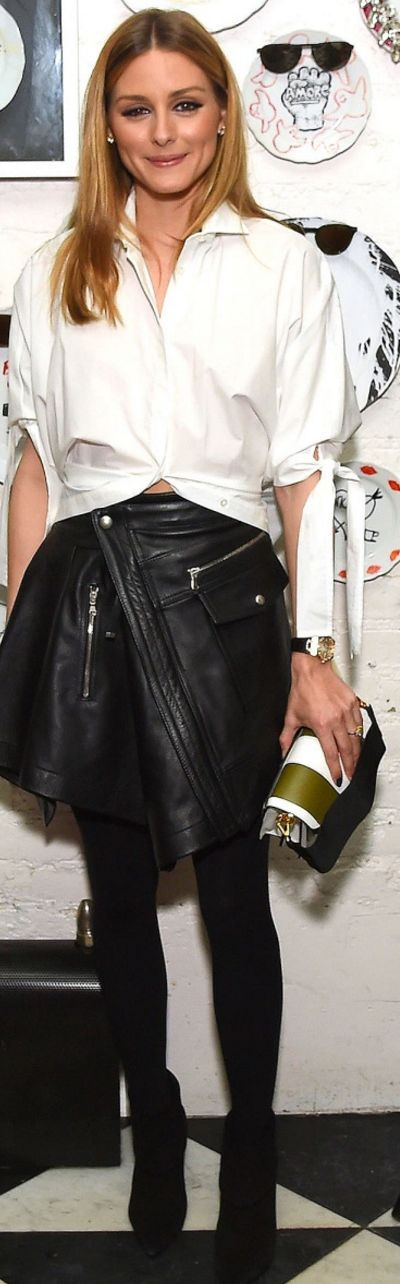 Who made  Olivia Palermo's suede ankle boots, striped handbag, and black leather wrap skirt?