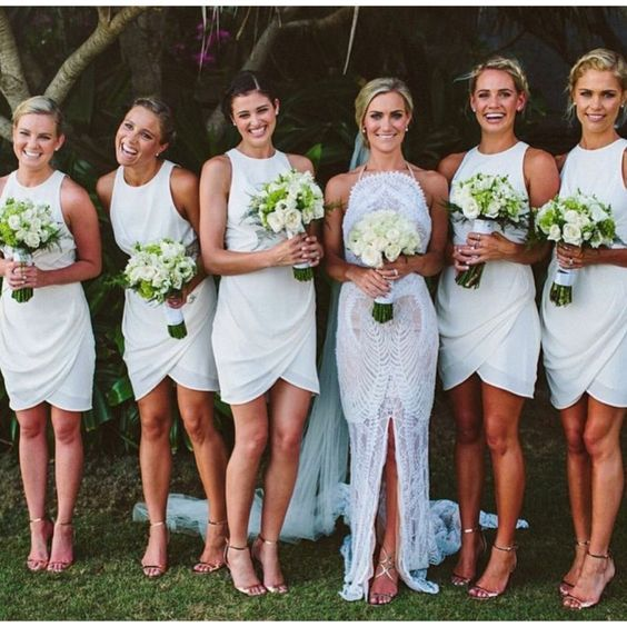 I like shape/fitting/length of the bridesmaids dresses but they'd have to be a different color for sure. love the bouquets too: