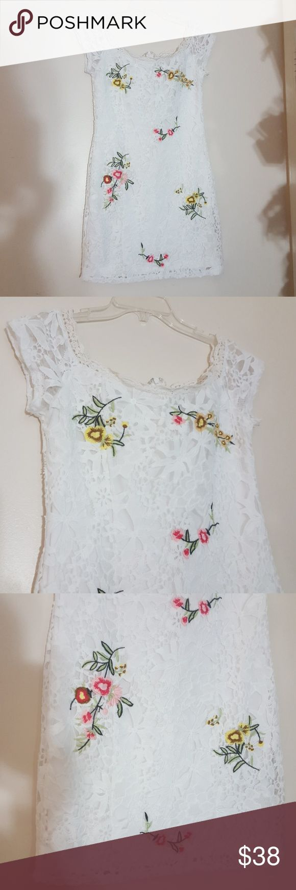 Floral embroidery lace dress Floral embroidery dress lace over solid white lining. Worn once. Like new. Very sexy. Buy a bundle and Save. From a smoke free home #lace #embroidery Forever 21 Dresses Mini