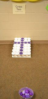 Easter Party- preschool style -- Cross Toss Game: try to get the plastic eggs in the purple cups (just insert purple paper into cups)