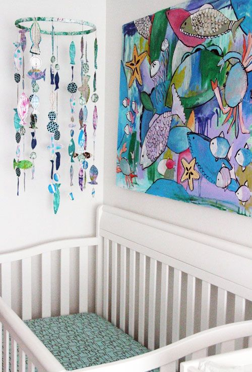 the fish mobile is really cool, but I'm in love with that painting on the wall. Just gorgeous (by Alisa Burke)