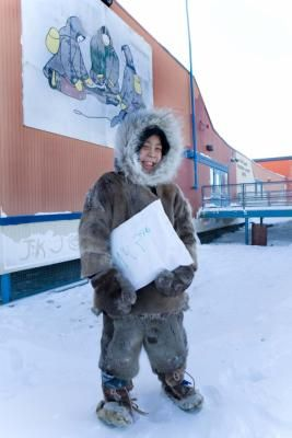 site that shows images of kids going to school around the world. Pinned image is of Inuit boy attending traditional school near Arctic circle.