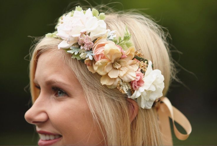 This dreamy floral hair wreath, the Blush, Ivory & Gold Bridal Flower Crown, is a rustic crown of dark brown bark-covered wire vine delicately looped into the shape of a halo. Sweet pip berries of ivory and old gold dance around the crown, with roses, delphinium, branch flowers, rosebuds and berries. Maidenhair fern, a touch of preserved babys breath and other greenery adorns the crown, with metallic gold leaves peaking out here and there. Two loops in back tie with satin ribbon ivory, be...