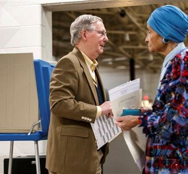 Senate Minority Leader Mitch McConnell of Ky. walks to turn in his ballot in the midterm election at the voting precinct at Bellarmine University in Louisville, Ky., Tuesday, Nov. 4, 2014. The Kentucky Senate race, with McConnell, a 30-year incumbent, facing a spirited challenge from Democrat Alison Lundergan Grimes, has been among the most combative and closely watched contests that could shift the balance of power in Congress. (AP Photo/J. Scott Applewhite)