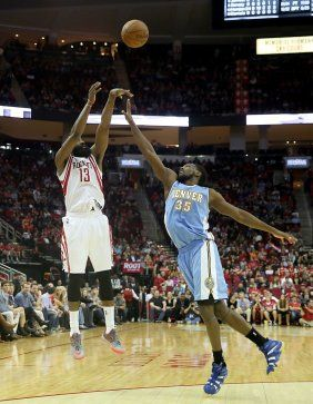 Rockets guard James Harden (13) shoots against Nuggets forward Kenneth Faried (35) in the second half.