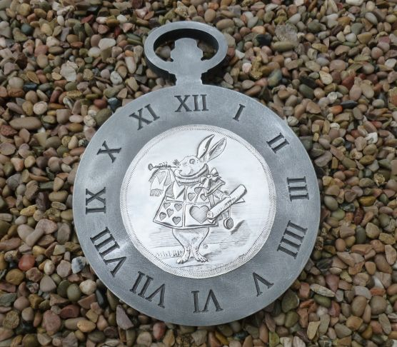 White Rabbit from Alice in Wonderland on clock face.  Hand crafted by Caroline at  Pewter Concepts.