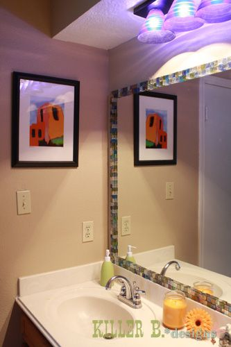 I am in the process of doing this to an old mirror in the hall bathroom.. so far I like the look but I have to get more tile and a cutter to fill in.. it is really fun and quick and so so easy..Mosaic Tile Framed Mirror — Spice up a builder grade mirror with glass tiles and EPO glue, and grout