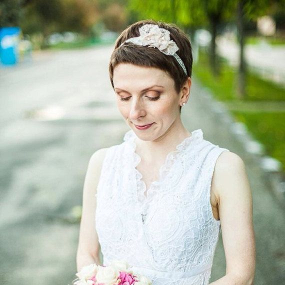 A bridal headband with handmade floral applique. I have created these soft blush pink flowers from a vintage lace, found in a tiny antique shop in