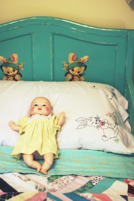 Bunny bed with vintage baby doll and old quilt hand crocheted and embroidery linens