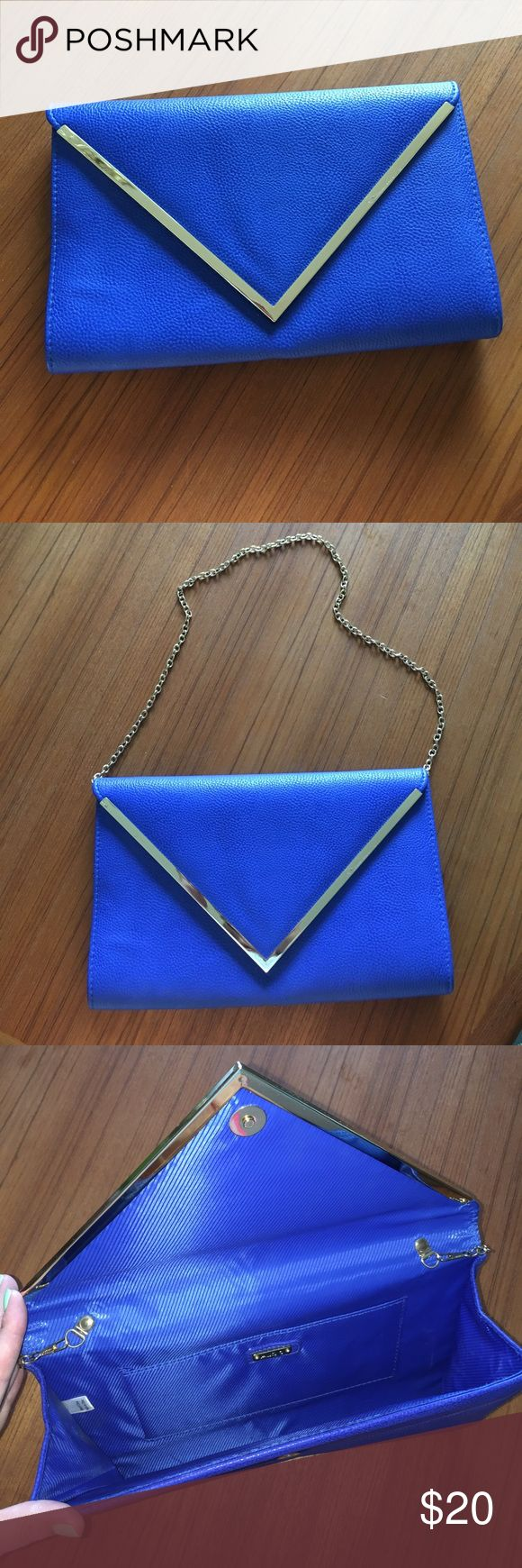 "Aldo Envelope Clutch/purse in royal blue Aldo envelope clutch/purse with gold metal strap (which hides nicely if want as clutch). Color is royal blue, really good condition. Small scratch on metal as shown in picture. Measures about 7 1/2"" tall & 12"" wide Aldo Bags"