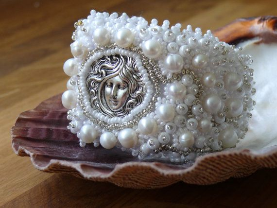 Hey, I found this really awesome Etsy listing at http://www.etsy.com/listing/100387676/bead-embroidered-bracelet-bridal-cuff