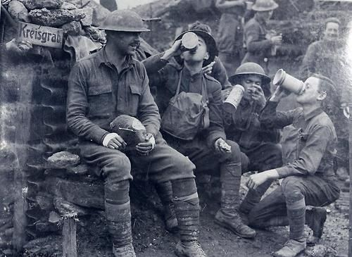 American soldiers of the 33rd Infantry Division enjoying beer,...