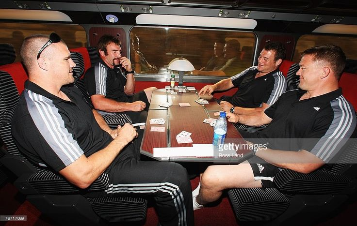 Keith Robinson, Andrew Hore, Tony Woodcock and Greg Somerville of the New Zealand All Blacks play cards during the high speed train trip on September 13, 2007 between Marseille and Lyon, France.