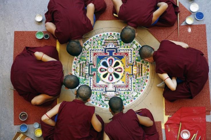 Female monks of the Khachoe Ghakyil monastry, Kopan in Nepal, creating a sand mandala