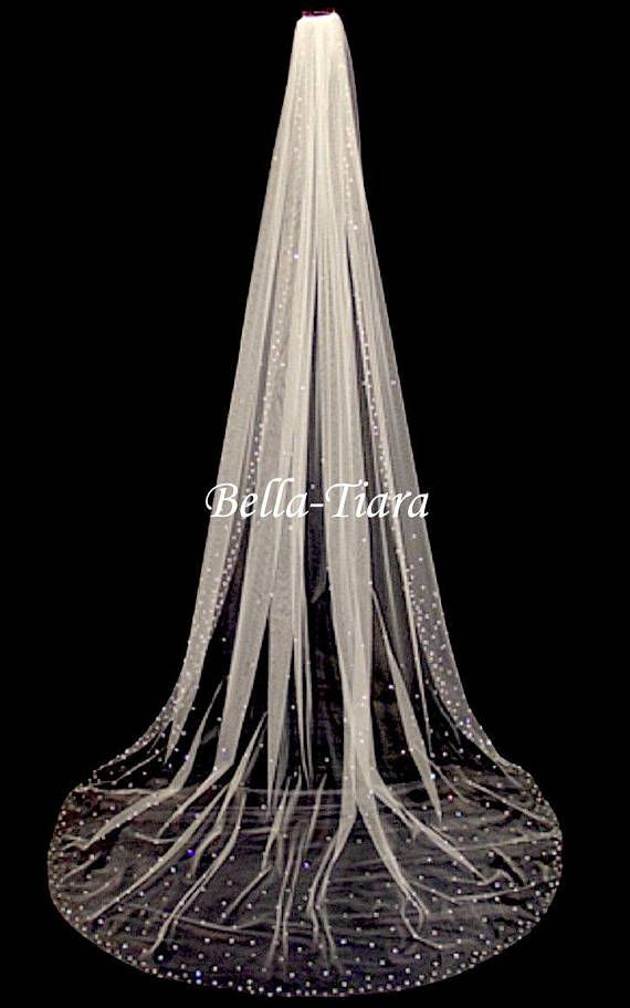 New to our handmade collection - Beautiful handmade soft illusion veil with slightly scattered small and medium swarovski crystals on a 3.5 metal comb attached.  soft illusion tulle veil, just the perfect veil and softness. chapel length 90 (floor length) Cathedral length 108 long royal length 120 long    CUSTOM LENGHT AVAILABLE CONTACT US beautiful matching free matching 30 blusher amazing price beautiful and elegant design.