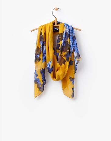 mustard yellow? yes! -- Our must have autumn accessory, update any outfit with our gold women's scarf.
