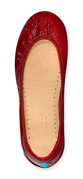 Step into the spotlight wherever you go in bold Ruby Red Patent Tieks! These show-stopping flats are sure to complete your look.