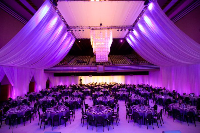 Amfar's Cinema Against AIDS During Toronto International Film Festival. Guests dined in the concert hall of the Carlu, lit in purple and dra... Photo: Kevin Tachman Photography