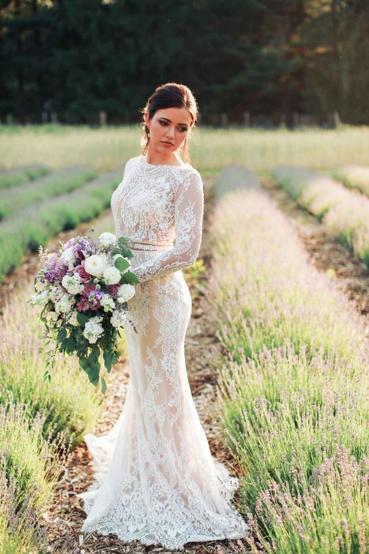 Long sleeve lace wedding dress with cascading purple and white bouquet - A Style Shoot in a Dreamy Lavender Field | WeddingDay Magazine