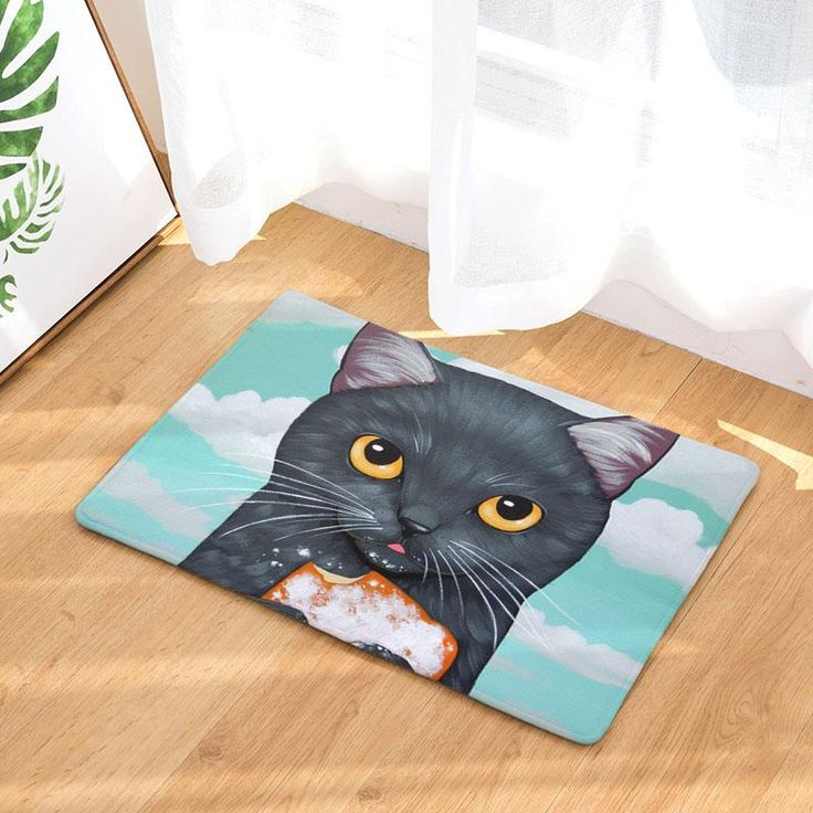 These insanely cute and colorful cat mats are great for under food and water bowls for your furry friends, as a welcome mat, or really anywhere that you'd like