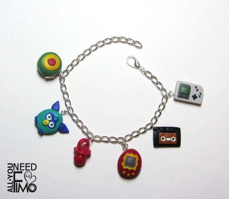 Bracelet with 90s gadgets inspired charms now in my Etsy Shop!  INFO: https://www.facebook.com/AllYouNeedIsFimo/photos/a.937250929688782.1073741828.932013750212500/1227300630683809/?type=3&theater #fimo #polymerclay #artigianato #fattoamano #handmade #bracciale #bracelet #ciondoli #charms #anni90 #90s #gameboy #tamagotchi #mixtape #yoyo #dummy #ciucciotto #furby #90sstuff #nostalgic #nerd #etsy #etsysellersofinstagram #epiconetsy #etsyshop #etsybuyers #etsysellers #allyouneedisfimo…