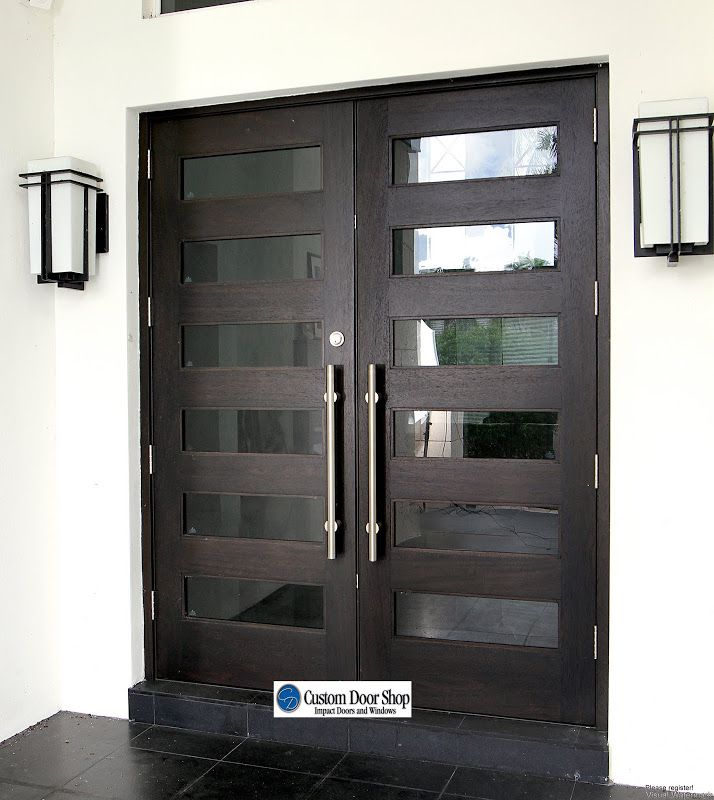 Amazing front doors! Contemporary mahogany double wood doors with glass inserts and large pulls. Perfect combination of contemporary and classic lines.