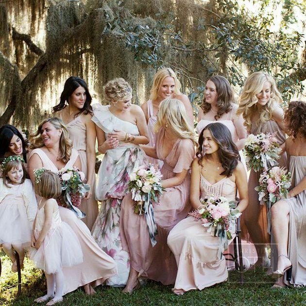 A gorgeous candid moment among bridesmaids   Brides.com