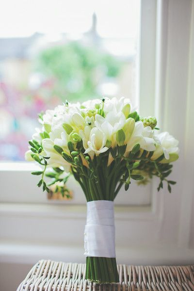 A glam and elegant bridal bouquet of Chincherinchee and white fragrant freesias by Flowers by Kirsty - www.flowersbykirsty.com