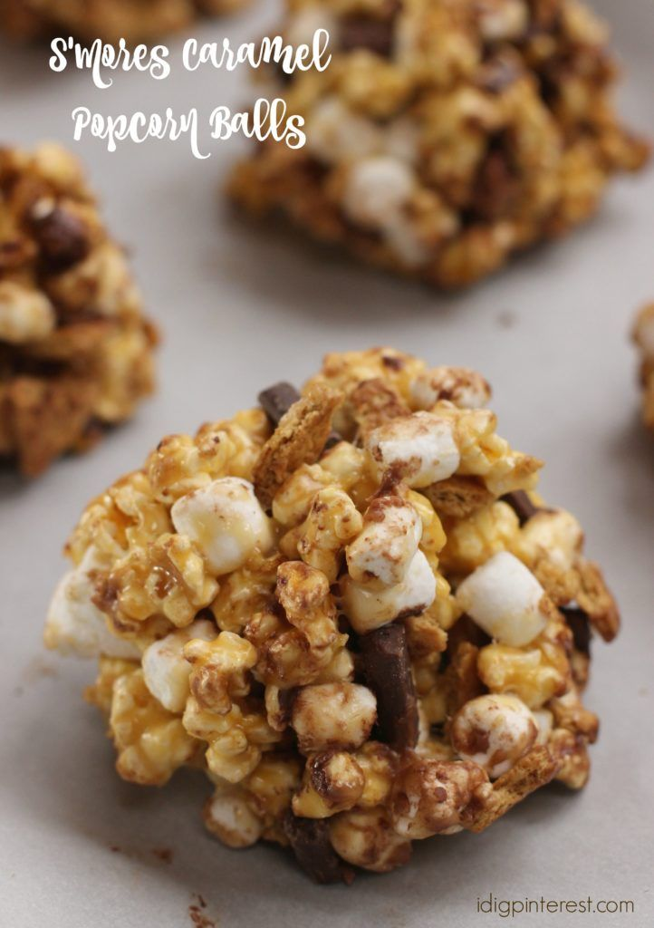 S'Mores Caramel Popcorn Balls. All the goodness of a S'more in a gooey, delicious caramel popcorn ball! Marshmallows, chocolate chunks, graham crackers, caramel and popcorn were meant to be together! These are sure to be a hit at your game time party, or any party for that matter! #AllStarSnackBar #ad