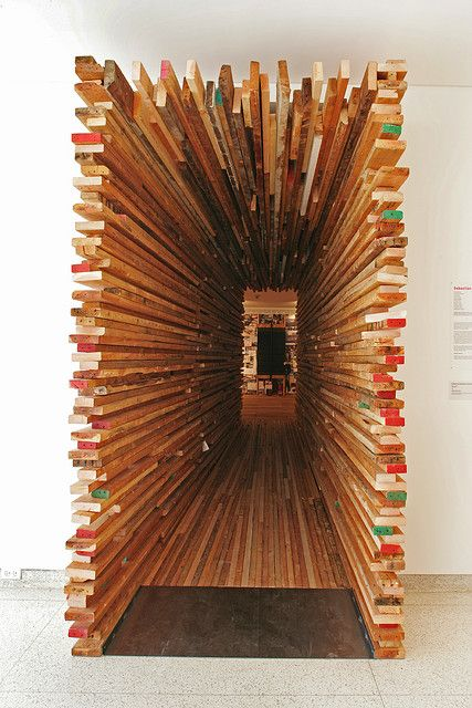 Sebastian Mariscal created a tunnel from plywood that serves as the entry point to the exhibition.