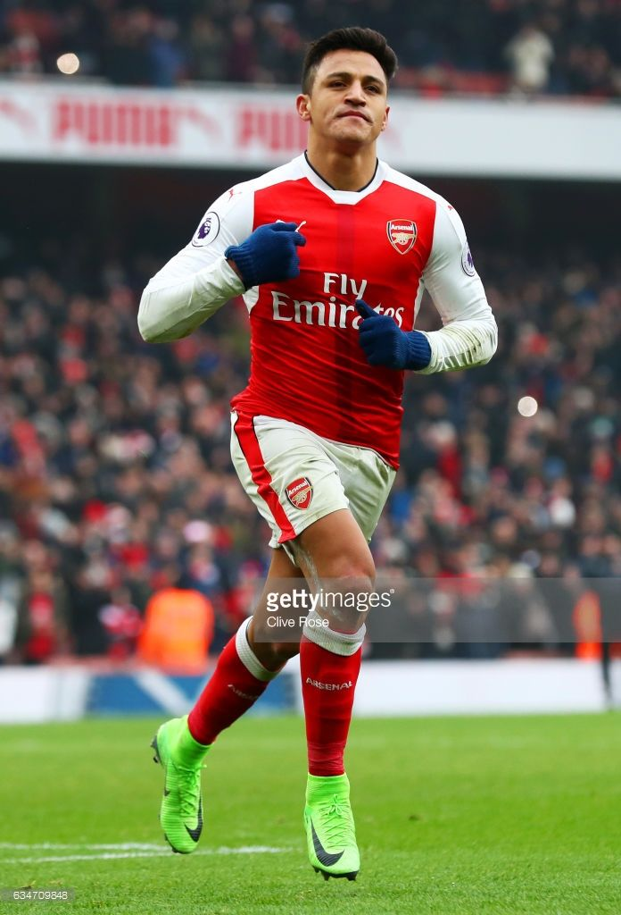 Alexis Sanchez of Arsenal celebrates scoring his side's second goal from the penalty spot during the Premier League match between Arsenal and Hull City at Emirates Stadium on February 11, 2017 in London, England.