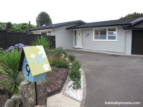 The quirky letterbox is just a taste of things to come at Sarah and Brian's home. The exterior was painted Resene Foggy Grey after they spotted the colour on another house and door-knocked for the paint name.  http://www.habitatbyresene.co.nz/sarah-and-brians-retro-revival