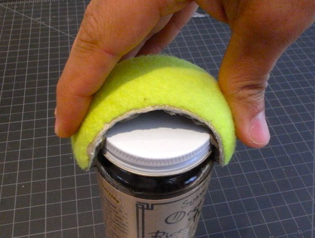 Tennis ball jar opener for those with poor grip. Repinned by SOS Inc. Resources pinterest.com/sostherapy/.