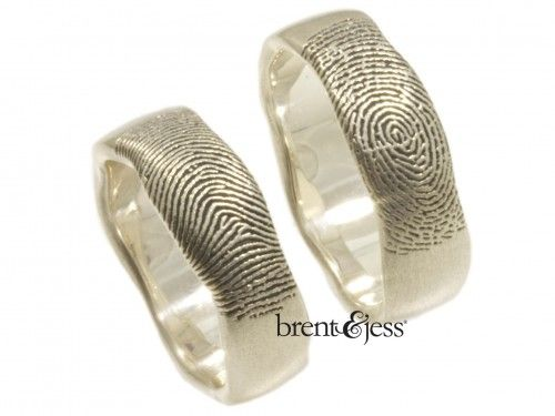 Set of You and Me Forever Comfort Fit Fingerprint Wedding Bands in Sterling Silver It's like you both just touched the ends of your fingers on the ring, each leaving your mark. A truly unique ring that you won't find in a catalog or mall jewelry store! This is just what you were looking for. It is many things: unique, sentimental, custom, heirloom quality crafted, and you are completely involved in the process. With our newest technology we carve your fingerprints into flat sterling s...