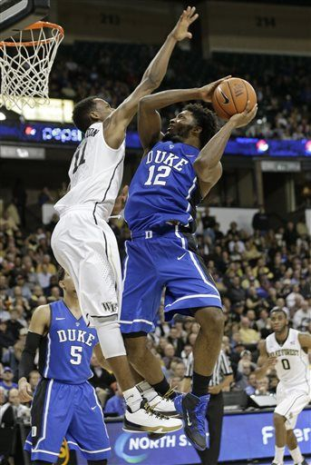 Duke's Justise Winslow (12) shoots over Wake Forest's Greg McClinton (11) during the second half of an NCAA college basketball game in Winston-Salem, N.C., ...