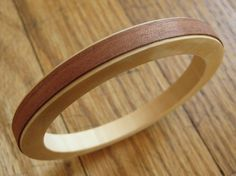 A strip of wood veneer added to a wooden bangle creates this sleek, fashionable bracelet.
